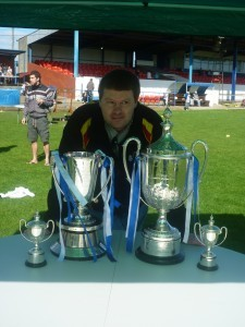 Peter Mann at Hillheads, home of Whitley Bay FC, with the FA Vase and Northumberland Senior Cup