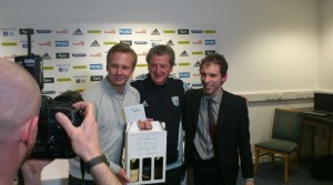 Dan, right, and a friend present Roy Hodgson with