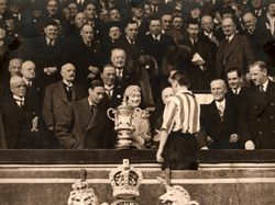 Our Raich (senior), collects the FA Cup in 1937 from the King's lass. Sixer says it was a fine match