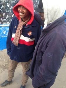 An Eritrean migrant at the Calais camp: now the grateful owner of M Salut's SAFC woolly pully