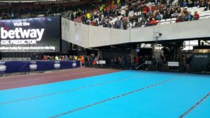 "Tarpaulin covering athletics seating (""The World's Stage"") some 20 feet below - no access to this. Wonder how Sir Trevor Brooking feels having this upper tier named after him?"